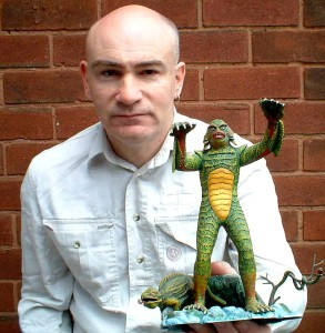 Dr Karl Shuker with Creature from the Black Lagoon reptoid model