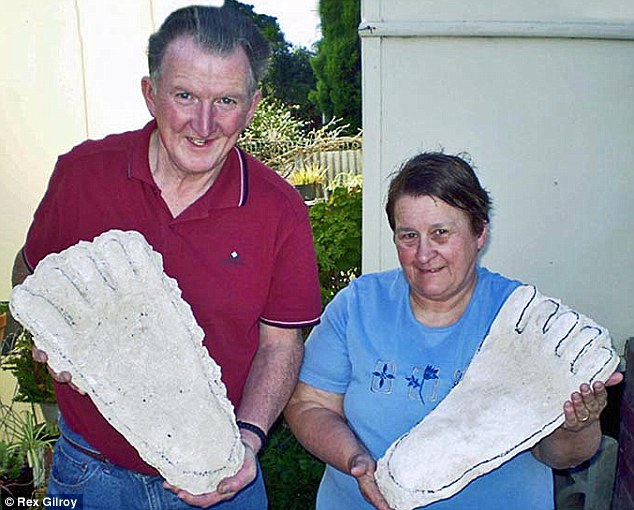 Enduring mystery: Husband and wife team Rex and Heather Gilroy have been on the case for 63-years, pictured with casts of Bigfoot and Yowie footprints