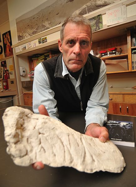 CONNECTION PHOTO: VERN UYETAKE - Eighth-grade science teacher Thom Powell with a plaster track cast of the Sasquatch in his classroom at Robert Gray Middle School.